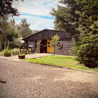 Secluded Cabin set in 5 Acres of Private land, with Exclusive use of Swimming Pool and Hot Tub for up to 10 Guests