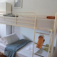 Bright room, with bunkbeds in owner`s house with use of shared bathroom.
