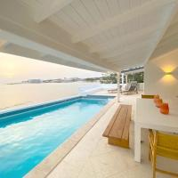Oceanfront four bedroom Villa comfortably accommodates 8 persons.