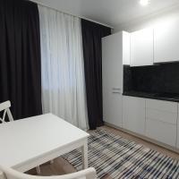Идеальные 1-к апартаменты для амбициозных людей, hotel in Kogalym
