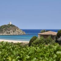 Baia Di Chia Resort Sardinia, Curio Collection By Hilton, hotel in Chia
