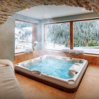 Luxury chalet sleeps 15 for perfect mountain holiday with sauna hot tub & ensuite bedrooms