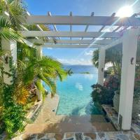 Luxury 7BR waterfront villa with views of Marina Cay and Scrub Island, hotel in East End