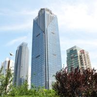 New Century Hotel Qingdao, отель в городе Huangdao