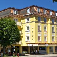 Hotel Schlosskrone, отель в Фюссене