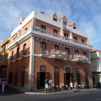 Café Royal Suites, отель в Минделу