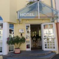 Hotel am Theater, отель в городе Шветцинген