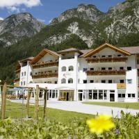 Hotel Alpin, отель в городе Колле-Изарко