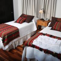 Río Arriba Suites & Apartments & Restó, hotel en Bella Vista