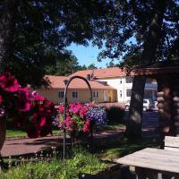 Bastö Hotel & Stugby, hotell i Pålsböle