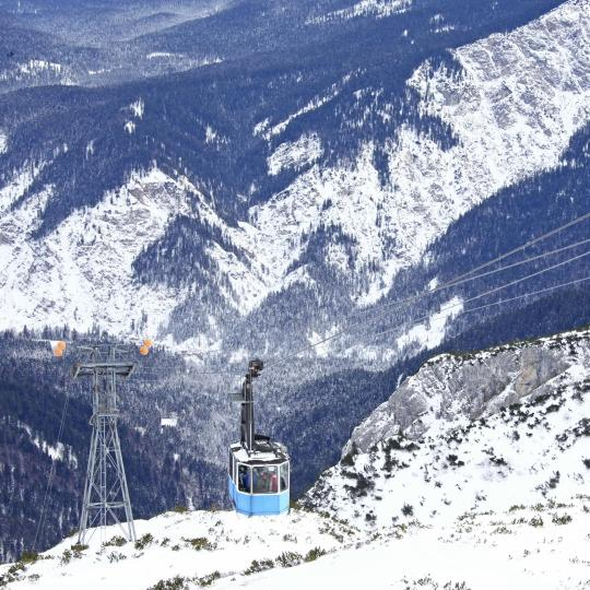 Ride a gondola up Alpspitz Mountain