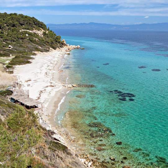 Afitos village and its beach