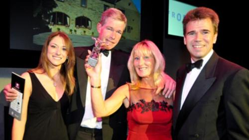 Andrew and Jayne ( centre ) receiving their White Rose Award
