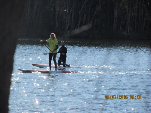 Elizabeth on paddle board.