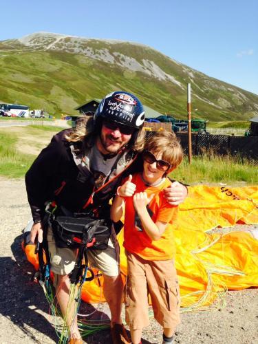 Mark paragliding with son Antonio