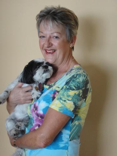 "Maggie (Owner) with her pet shitzu dog ""Zorra"""