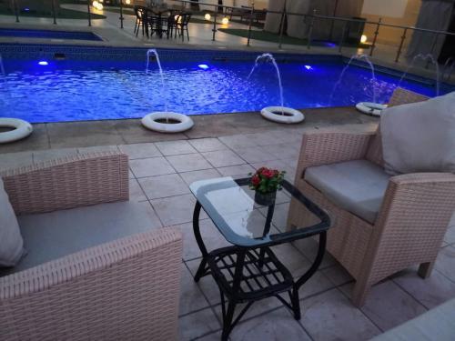 Dist Inn Hotel Aprt / تَمَيُّز الإقامة